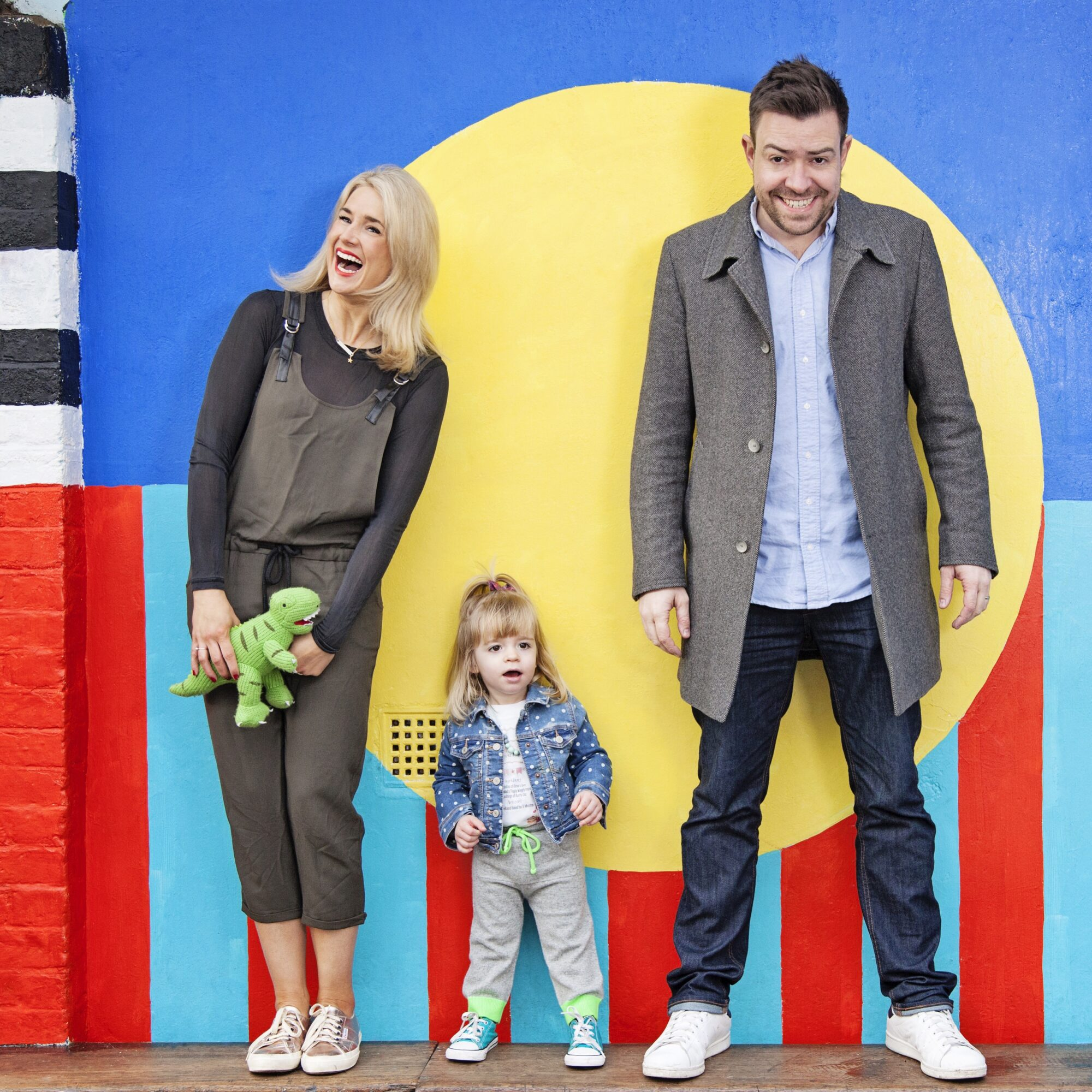 Anna from Mother Pukka, with her daughter Mae and Instagram-husband Matt, in Hackney. Photographed against wall murals painted by Camille Walala.