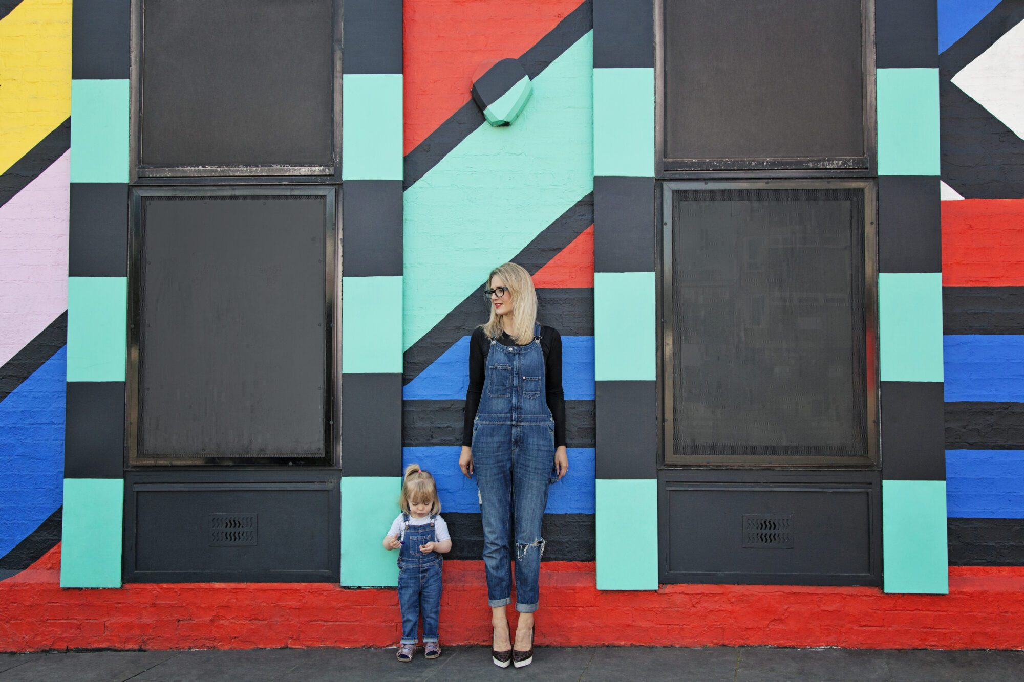Anna from Mother Pukka, with her daughter Mae, in Shoreditch. Photographed outside the Splice TV building painted by Camille Walala.